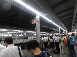Japanese workers waiting for trains home late night